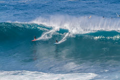 Waimea bay Oahu Hawaii, Surfers ride a big wave Stock Photo