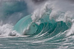 Waimea Beauty. A giant winter swell wave finishes it's long transpacific journey on the north shore of oahu Stock Photography