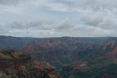 Waimea Canyon on Kauai, Hawaii, in winter after a major rainstorm. The dirt is all soaked and has the deep rich red coloring Royalty Free Stock Image