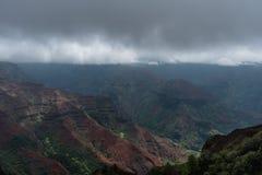 Waimea Canyon on Kauai, Hawaii, in winter after a major rainstorm. Under a heavily overcast sky Royalty Free Stock Photos