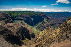 Waimea Canyon - Kauai. There is a chopper somewhere in this picture. Once you find it you will have an idea of the magnitude of this place - Waimea Canyon Royalty Free Stock Images