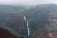 Waimea Canyon and Waipoo Falls on Kauai, Hawaii, in winter after a major rainstorm stock images