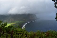 Waimea Valley Hawaii Overlook Foggy view of Coast. Heavy cloud cover of fertile utopian paradise valley from top of mountain with. Mountains in the distance royalty free stock images