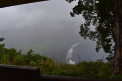 Waimea Valley Hawaii Overlook Foggy view of Coast. Heavy cloud cover of fertile utopian paradise valley from top of mountain with stock image