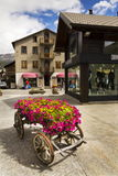 Wain with flowers in front of fashion shops on streets of duty-free area on 1 August 2016 in Livigno, Italy. Stock Image