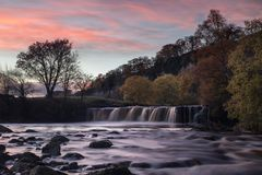 Wain Wath Sunset. Wain Wath falls as the sun sets Royalty Free Stock Images