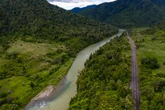 Waioeka River and Gorge Road, Aerial View. Mountain road towards Gisborne, aerial view of SH2 following river and historic bridge royalty free stock photo