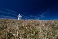 Waipapa Lighthouse and dark blue sky - New Zealand stock photo