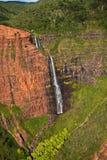 Waipoo Falls in Waimea Canyon, Kauai. Waipo'o Falls plunges more than 800 feet down a dramatic red rock face in Waimea Canyon, Kauai (Hawaii). Helicopter aerial Stock Photo