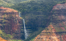 Waipoo Falls, Waimea Canyon Kauai, Hawaii. Waipoo Falls drops 800 feet to the bottom of Waimea Canyon on Kauai, Hawaii Royalty Free Stock Photography