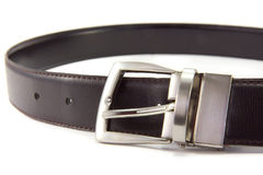 Waist belt. A men's leather belt with metal buckle on a white background stock photos
