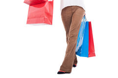 Waist down view of woman carrying shopping bags Stock Image
