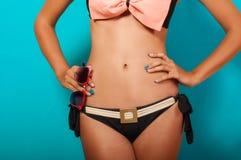 Waist girl in bikini with sunglasses Stock Images