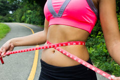 Waist measurement on a fit woman Royalty Free Stock Images