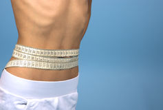 Waist measuring with tapeline Royalty Free Stock Image