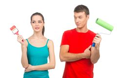 Waist up of boy and girl decorating home. Royalty Free Stock Image