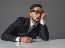 Tired businessman is sleeping at the table royalty free stock photography