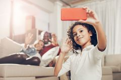 Happy girl making selfie with mother and father Royalty Free Stock Photography
