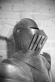 Waist up and helmet of ancient armor from medieval war (black and white) Royalty Free Stock Photo