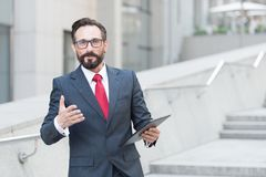 Free Waist Up Of Affluent Businessman Having A Talk With You While Holding A Tablet In Hand Stock Photo - 161362370