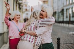Pretty old ladies are happy to meeting stock photo