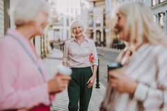 Pretty white-haired woman is going to friends royalty free stock image