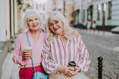 Two pretty ladies standing on the street stock image