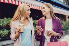 Cheerful young lady chatting with mother on the street stock photos