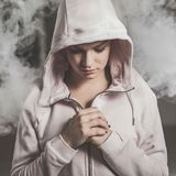 Beautiful woman in white fog stock images