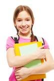 Happy smiling schoolgirl with books Stock Photos