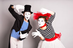 Waist-up portrait of funny mime couple with white faces. April Fools' Day - concept Royalty Free Stock Photo