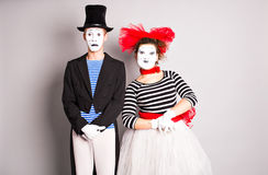Waist-up portrait of funny mime couple with white faces. The concept of Valentine's Day, April Fool's Day Royalty Free Stock Image