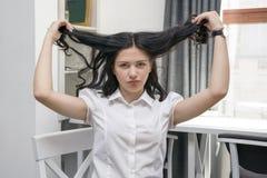 Brunette displeased girl stock images
