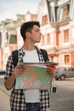 Waist-up portrait of handsome male traveler on the Royalty Free Stock Photography