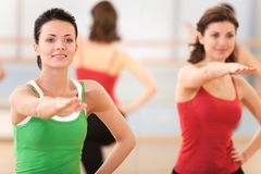 Waist up portrait of instructor with fitness class. royalty free stock images