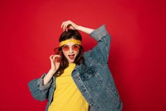 Coquettish hipster girl posing isolated on red royalty free stock photos