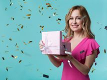 Excited woman holding present box royalty free stock image