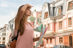 Waist-up portrait of pretty female traveler on the Stock Photos