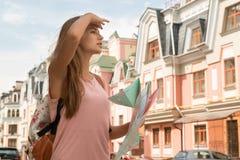 Waist-up portrait of pretty female traveler on the Stock Photos