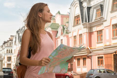 Waist-up portrait of pretty female traveler on the Stock Photography