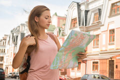 Waist-up portrait of pretty female traveler on the Royalty Free Stock Photography
