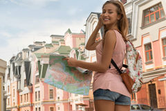 Waist-up portrait of pretty female traveler on the Royalty Free Stock Image