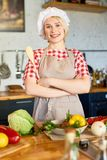Pretty Young Housewife in Chefs Hat Stock Photos