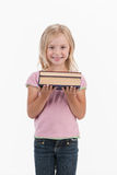 Waist up portrait of school girl holding books. Royalty Free Stock Photography