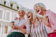 Three beautiful old ladies have fun together royalty free stock images