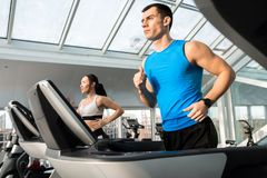 Clients Running on Treadmills royalty free stock photography