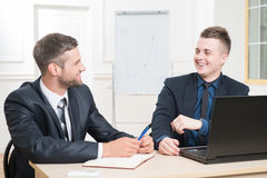 Waist-up portrait of two handsome businessmen in Royalty Free Stock Image