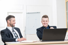 Waist-up portrait of two handsome businessmen in Royalty Free Stock Photo