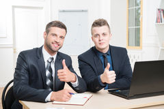 Waist-up portrait of two handsome businessmen in Royalty Free Stock Images