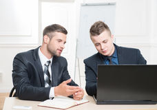 Waist-up portrait of two handsome businessmen in Stock Photography